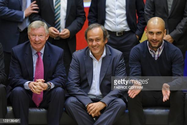 Manchester United's manager Alex Ferguson UEFA president Michel Platini and Barcelona's coach Josep Guardiola pose during a family picture on August...