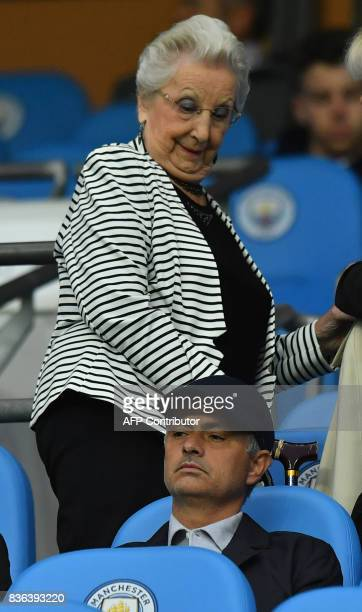 Manchester United's manager Jose Mourinho is recognised by a spectator before the English Premier League football match between Manchester City and...