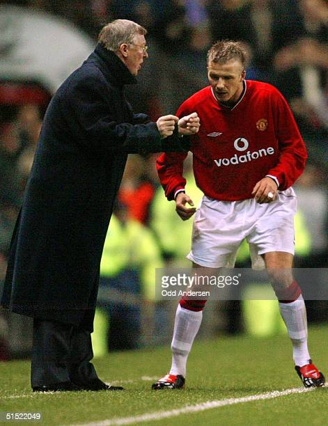 Manchester United's manager Sir Alex Ferguson gives instructions to David Beckham during a champions league match at Old Trafford in Manchester 26...