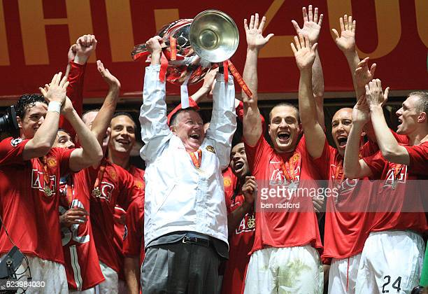 Manchester United's Manager Sir Alex Ferguson holds aloft the European Cup and celebrates with his players after winning the UEFA Champions League...