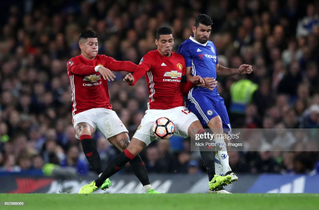 Manchester United's Marcos Rojo, Chris Smalling and Chelsea's Diego Costa battle for the ball during the Emirates FA Cup, Quarter Final match at Stamford Bridge, London.