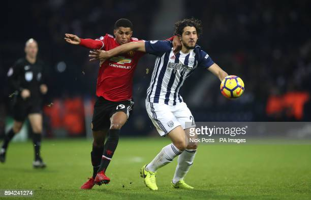 Manchester United's Marcus Rashford and West Bromwich Albion's Ahmed Hegazi battle for the ball during the Premier League match at The Hawthorns West...