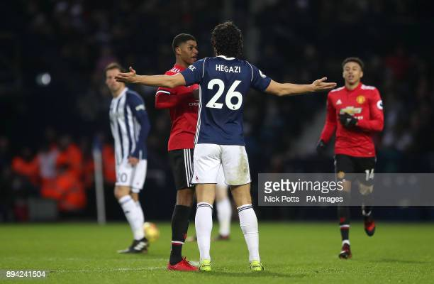 Manchester United's Marcus Rashford and West Bromwich Albion's Ahmed Hegazi clash after a challenge during the Premier League match at The Hawthorns...