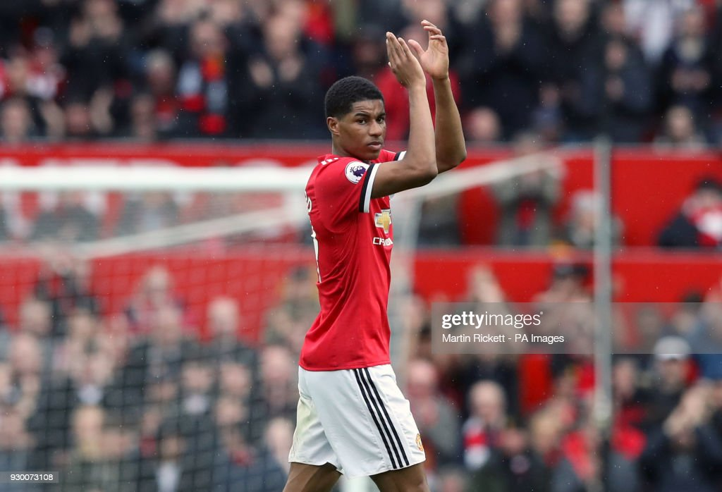 Manchester United's Marcus Rashford applauds the fans as he is substituted during the Premier League match at Old Trafford, Manchester.