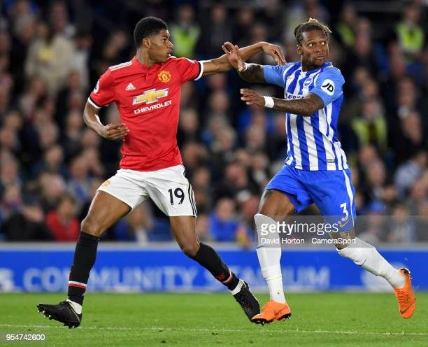 Manchester United's Marcus Rashford battles with Brighton Hove Albion's Gaetan Bong during the Premier League match between Brighton and Hove Albion...