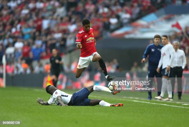 Manchester United's Marcus Rashford is challenged by Tottenham Hotspur's Davinson Sanchez during the Emirates FA Cup Semi Final match between...