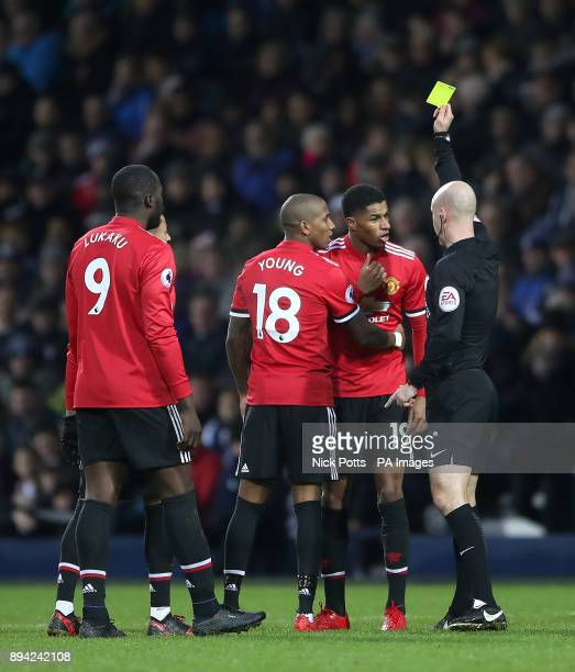 Manchester United's Marcus Rashford is shown a yellow card after a clash with West Bromwich Albion's Ahmed Hegazi during the Premier League match at...