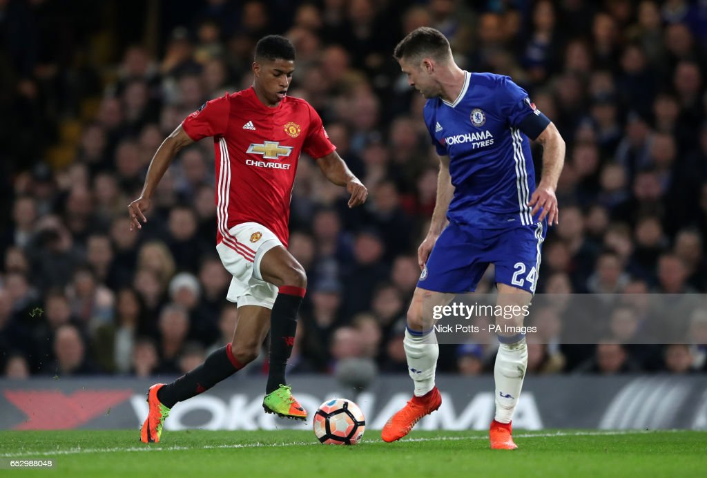 Manchester United's Marcus Rashford runs at Chelsea's Gary Cahill during the Emirates FA Cup, Quarter Final match at Stamford Bridge, London.