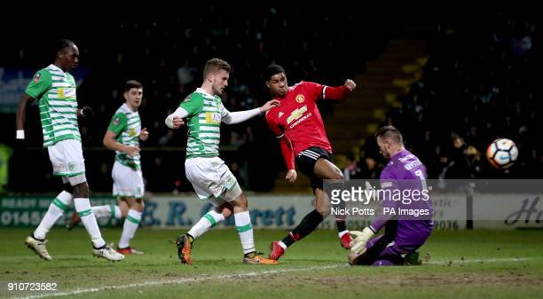 Manchester United's Marcus Rashford scores his side's first goal of the game during the Emirates FA Cup fourth round match at Huish Park Yeovil