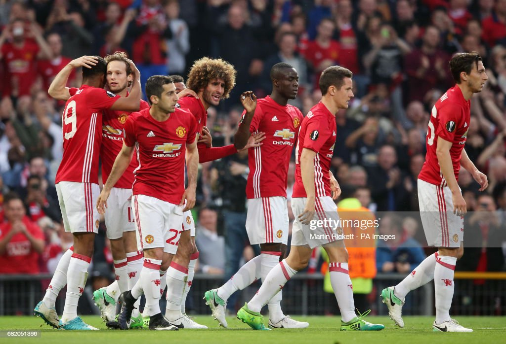 Manchester United's Marouane Fellaini (centre left) celebrates scoring his side's first goal of the game with team-mates during the UEFA Europa League, Second Leg match at Old Trafford, Manchester.