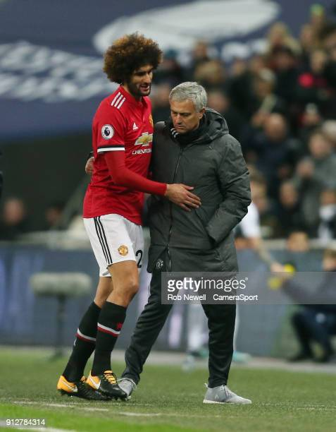 Manchester United's Marouane Fellaini is substituted and is consoled by Jose Mourinho during the Premier League match between Tottenham Hotspur and...