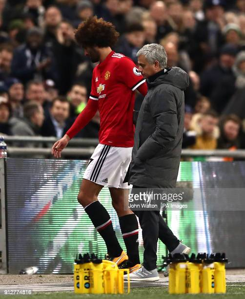 Manchester United's Marouane Fellaini is substituted off the pitch due to an injury during the Premier League match at Wembley Stadium London
