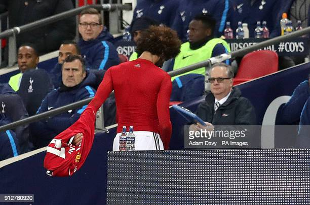 Manchester United's Marouane Fellaini looks frustrated after being substituted after just 8 minutes during the Premier League match at Wembley...