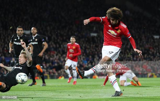 Manchester United's Marouane Fellaini shoots during the UEFA Champions League round of 16 second leg match at Old Trafford Manchester
