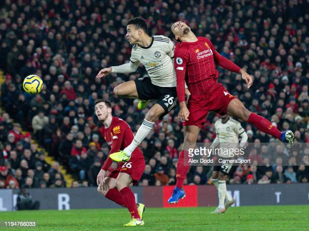 Manchester United's Mason Greenwood battles with Liverpool's Virgil van Dijk during the Premier League match between Liverpool FC and Manchester...