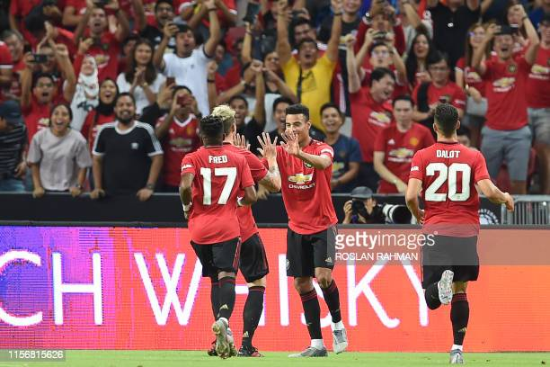 Manchester United's Mason Greenwood is congratulated by teammates after scoring during the International Champions Cup football match between...