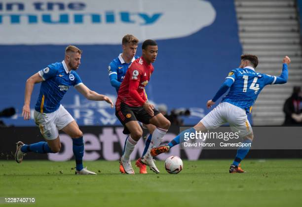 Manchester United's Mason Greenwood under pressure from Brighton Hove Albion during the Premier League match between Brighton Hove Albion and...