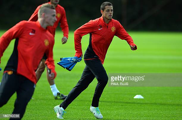 Manchester United's Mexican striker Javier Hernandez runs during a training session at the team's Carrington training ground in Manchester northwest...