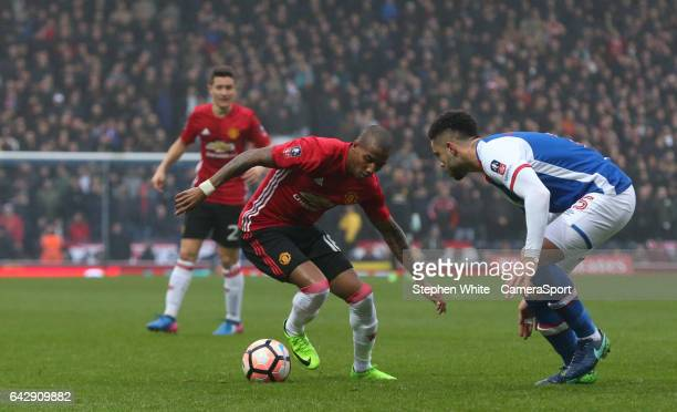 Manchester United's Michael Carrick battles with Blackburn Rovers' Derrick Williams during the Emirates FA Cup Fifth Round match between Blackburn...
