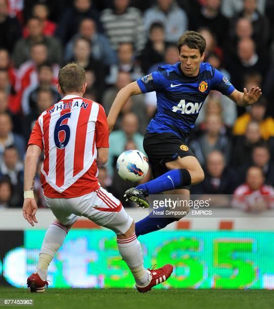 Manchester United's Michael Owen controls the ball as Stoke City's Glenn Whelan looks on
