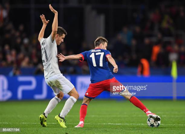 Manchester United's midfielder from Spain Ander Herrera and CSKA Moscow's midfielder from Russia Aleksandr Golovin vie for the ball during the UEFA...