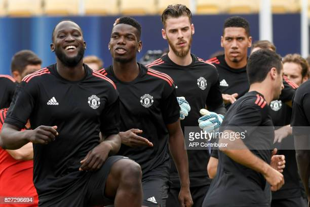 Manchester United's midfielder Paul Pogba and Romelu Lukaku warm up during a training session before the UEFA Super Cup 2017 football match between...