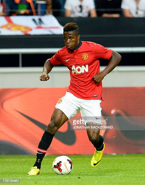 Manchester United's midfielder Wilfried Zaha controls the ball during a friendly football match between AIK and Manchester United on August 6 2013 at...