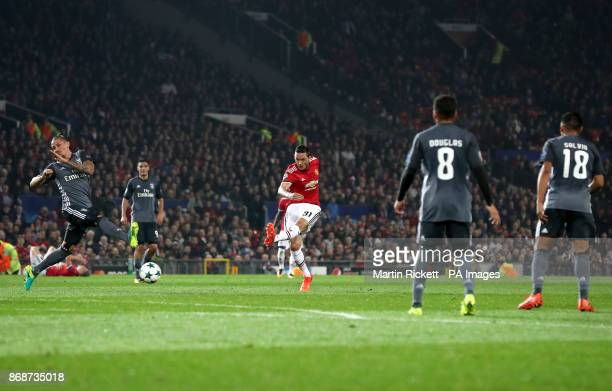 Manchester United's Nemanja Matic shoots for goal which results in an own goal by Benfica's goalkeeper Mile Svilar during the UEFA Champions League...
