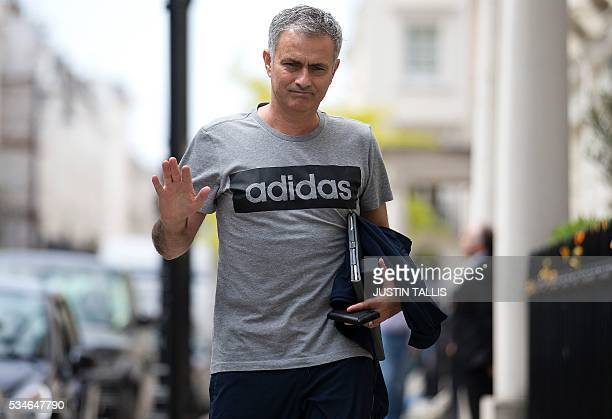 Manchester United's new Portuguese manager Jose Mourinho waves as he returns to his home in central London on May 27 2016 Manchester United on Friday...