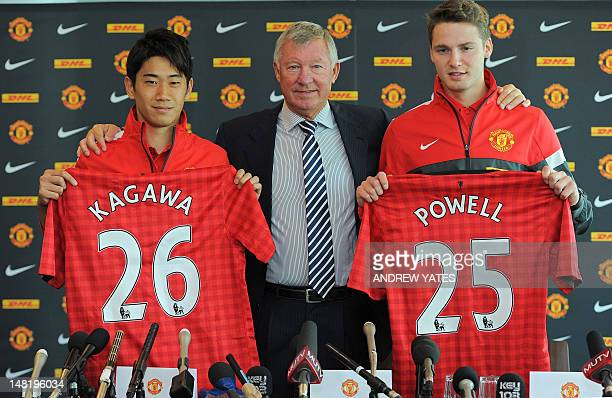 Manchester United's new signing Japanese midfielder Shinji Kagawa attends a press conference with Manchester United manager Alex Ferguson and fellow...