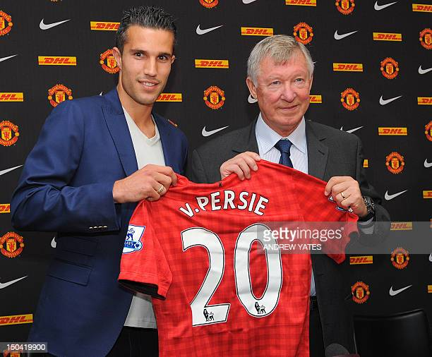 Manchester United's new signing Robin Van Persie attends a press conference with Manchester United manager Alex Ferguson at Old Trafford in...