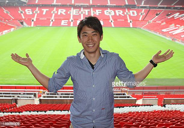 Manchester United's new signing Shinji Kagawa from Borussia Dortmund poses at Old Trafford on June 22, 2012 in Manchester, United Kingdom.
