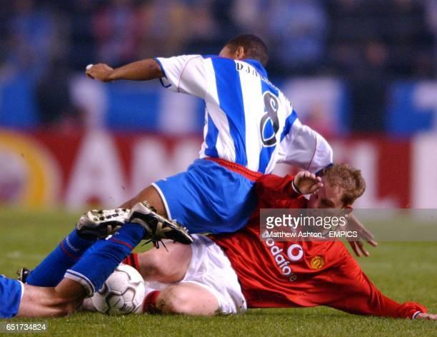Manchester United's Nicky Butt tackles Deportivo La Coruna's Djalminha