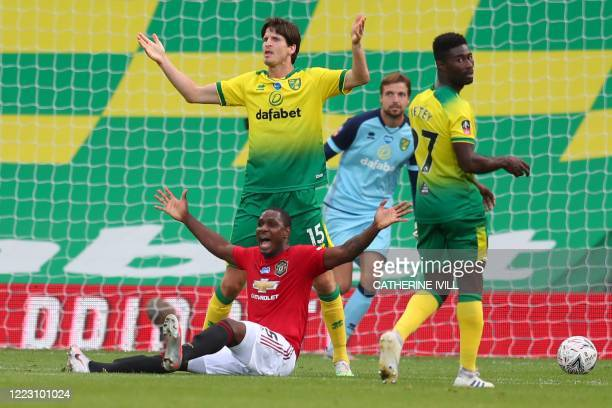 Manchester United's Nigerian striker Odion Ighalo appeals after being fouled by Norwich City's German-born Swiss defender Timm Klose a challenge for...