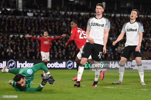 Manchester United's Nigerian striker Odion Ighalo celebrates scoring his team's second goal during the English FA Cup fifth round football match...