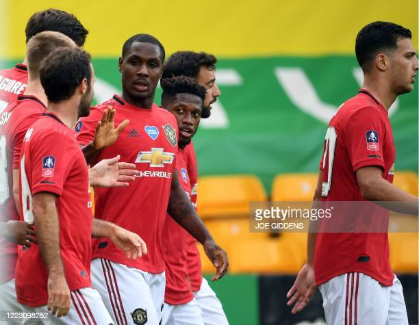 Manchester United's Nigerian striker Odion Ighalo celebrates scoring during the English FA Cup quarter-final football match between Norwich City and...