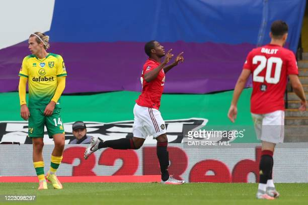 Manchester United's Nigerian striker Odion Ighalo celebrates scoring the opening goal during the English FA Cup quarter-final football match between...