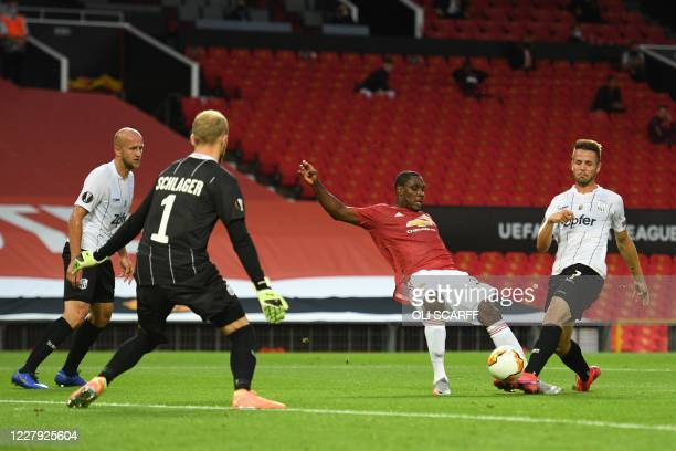 Manchester United's Nigerian striker Odion Ighalo has a shot blocked by LASK's Austrian midfielder Rene Renner during the UEFA Europa League last 16...