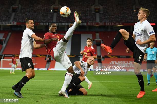 Manchester United's Nigerian striker Odion Ighalo hooks the ball away during the UEFA Europa League last 16 second leg football match between...