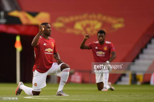 Manchester United's Nigerian striker Odion Ighalo kneels before the UEFA Europa League last 16 second leg football match between Manchester United...