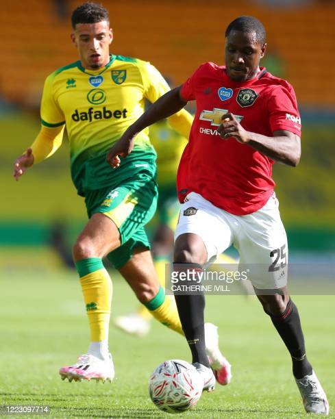 Manchester United's Nigerian striker Odion Ighalo runs away from Norwich City's English midfielder Ben Godfrey during the English FA Cup...