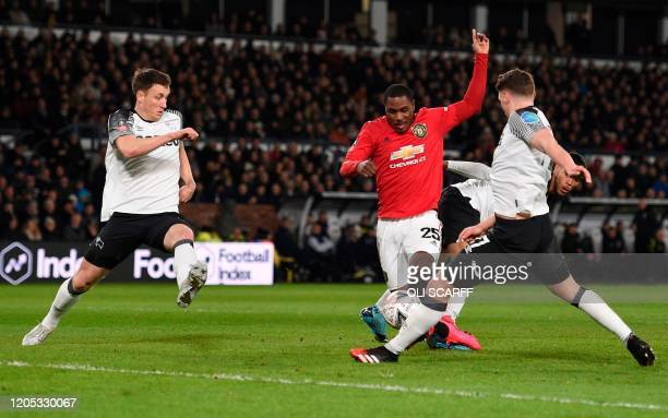 Manchester United's Nigerian striker Odion Ighalo scores his team's second goal during the English FA Cup fifth round football match between Derby...