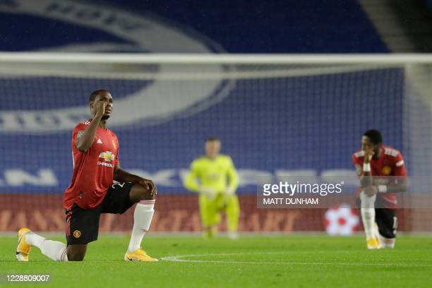 Manchester United's Nigerian striker Odion Ighalo takes the knee during the English League Cup fourth round football match between Brighton and Hove...
