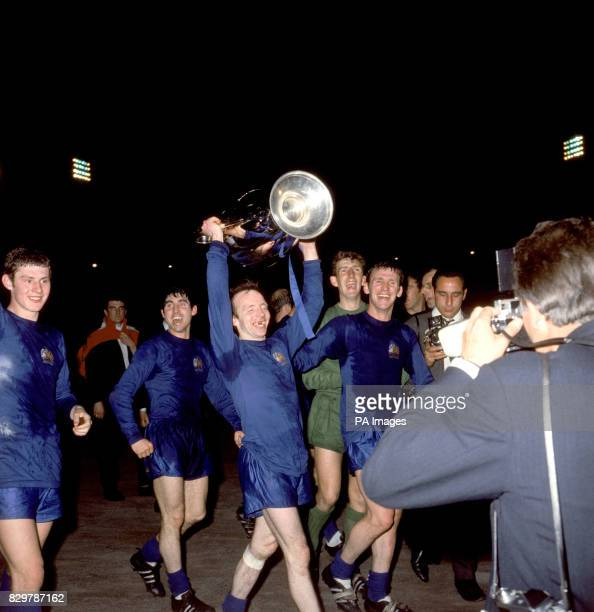 Manchester United's Nobby Stiles celebrates with the European Cup after his team's 41 win as he and his teammates perform a lap of honour Brian Kidd...