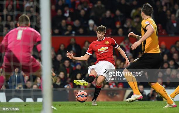 Manchester United's Northern Irish midfielder Paddy McNair has an unsuccessful shot during the FA Cup fourth round replay football match between...