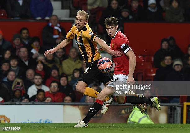 Manchester United's Northern Irish midfielder Paddy McNair vies with Cambridge United's English midfielder Luke Chadwick during the FA Cup fourth...