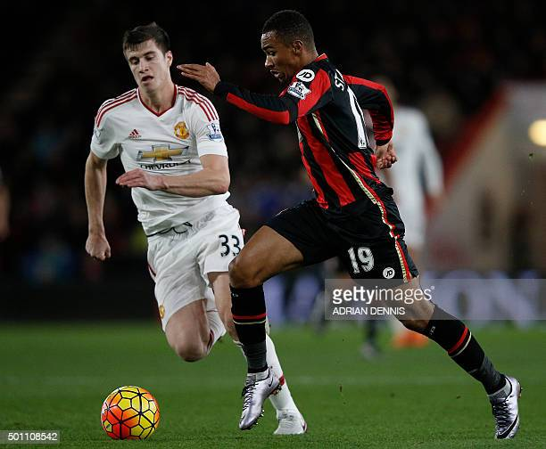 Manchester United's Northern Irish midfielder Paddy McNair vies with Bournemouth's English midfielder Junior Stanislas during the English Premier...