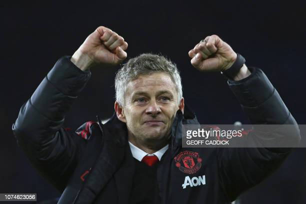 Manchester United's Norwegian caretaker manager Ole Gunnar Solskjaer celebrates on the pitch after the English Premier League football match between...