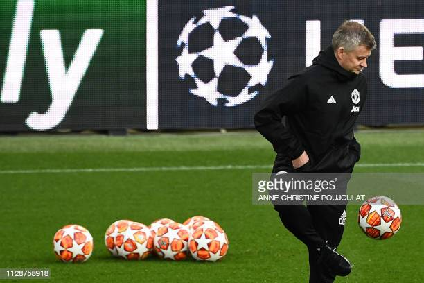 Manchester United's Norwegian caretaker manager Ole Gunnar Solskjaer attends a training session at the Parc des Princes stadium in Paris on March 5...