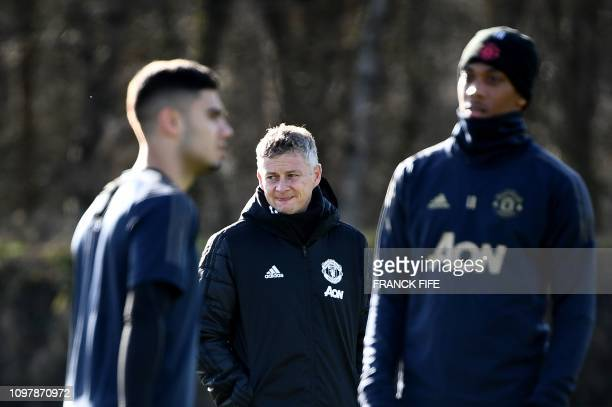 Manchester United's Norwegian head coach Ole Gunnar Solskjaer looks as his players during a training session at the Carrington Training complex in...